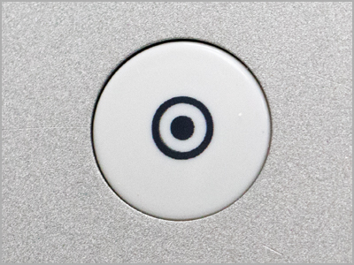 Botão de arremate automático do ponto na máquina