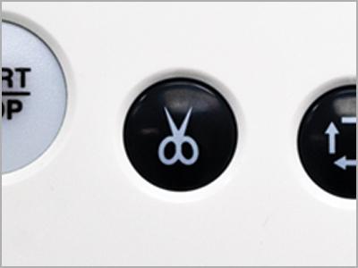 Botão de corte de linha na unidade RCS na máquina MB-7