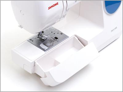 Caixa para armazenar os acessórios na máquina de costura doméstica Janome DC6100